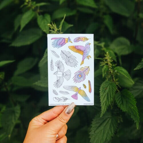 woman holding colored stickers with boho birds pattern