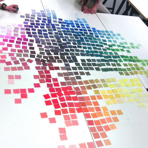 Collection of Square Color Cards Displayed on a Table at Art University