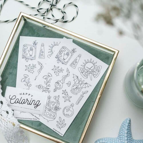 magical adult coloring stickers flatlay
