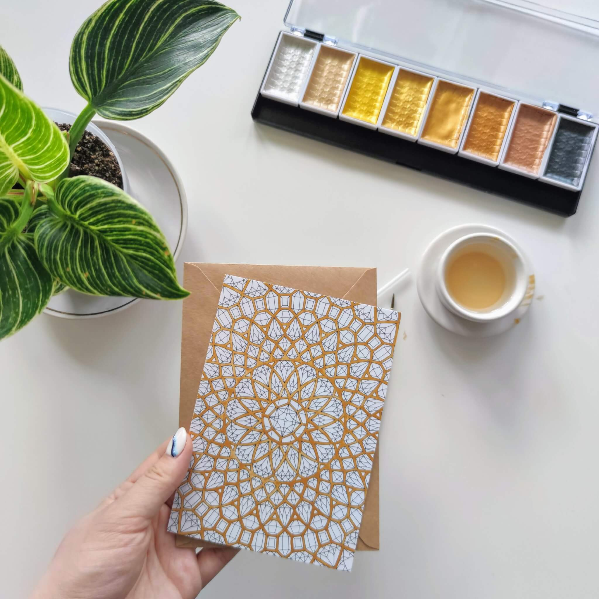 adding sparkle to adult coloring with gold paint background