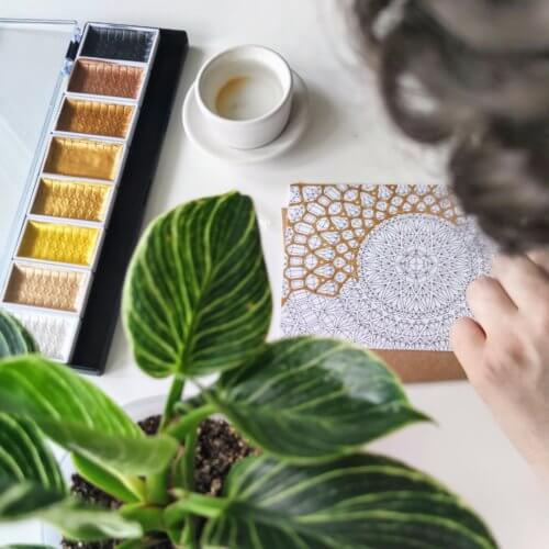 adding sparkly gold paint to adult coloring pages