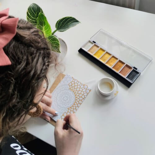 anna grunduls coloring postcard with gold paint